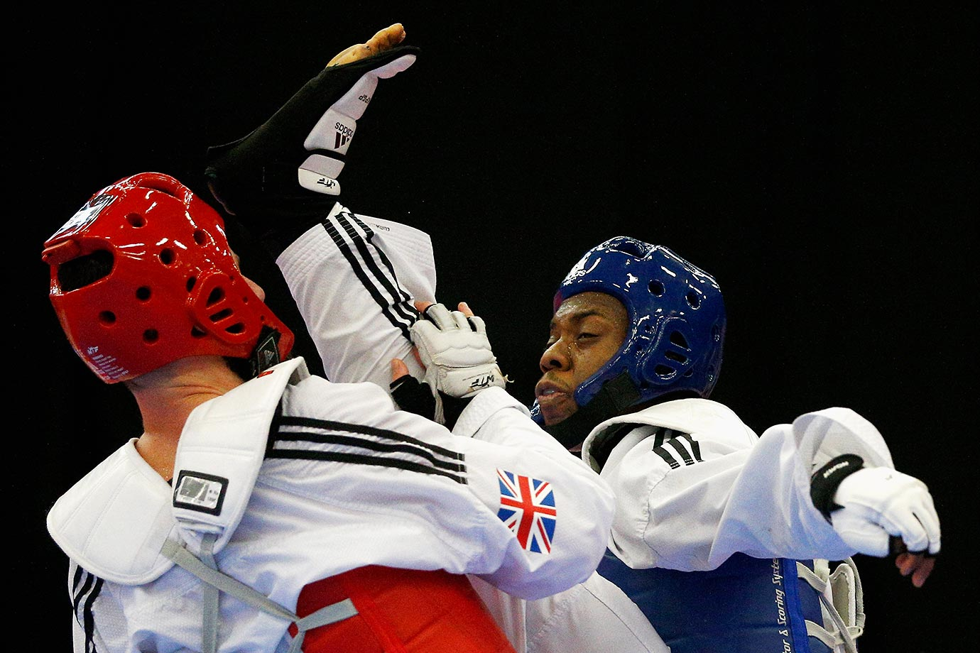 Lutalo Massop Muhammad (blue) and Damon Sansum compete in the World Taekwondo Grand Prix in England.