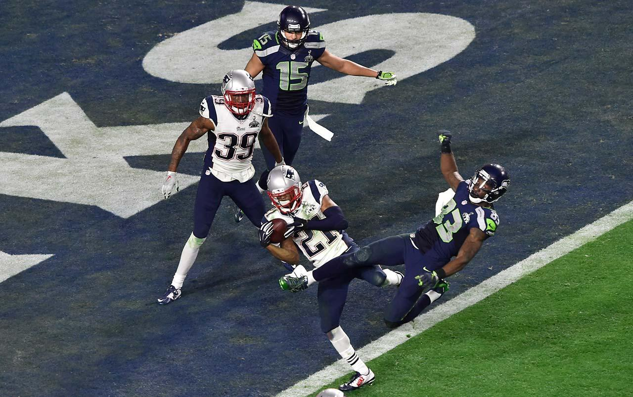 Malcolm Butler intercepts a pass intended for Richardo Lockette to prevent the Seahawks from scoring a would-be winning touchdown in the final minute. Butler's first career interception gave the Patriots their fourth Super Bowl victory in the past 14 years.