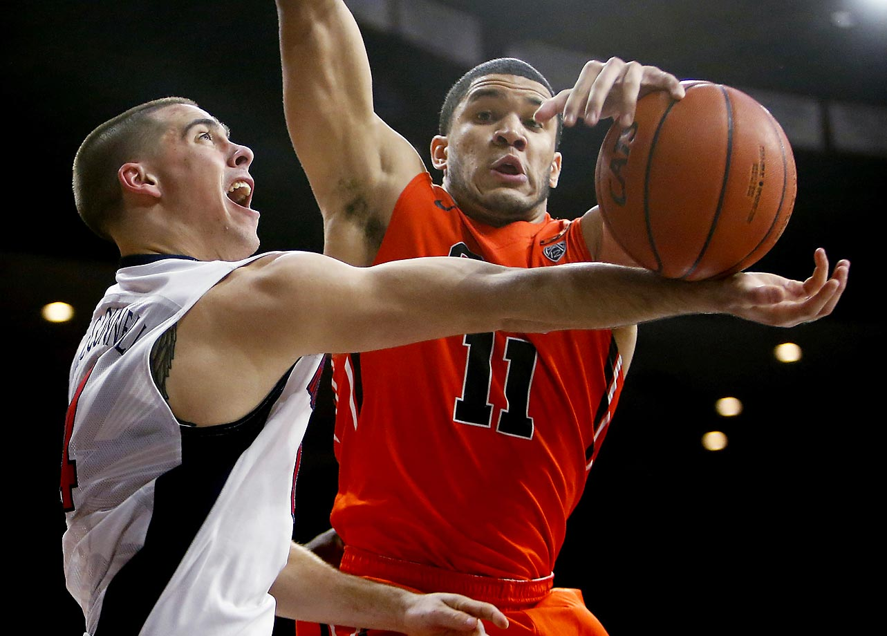 Arizona guard T.J. McConnell loses his grip against Malcolm Duvivier of Oregon State.