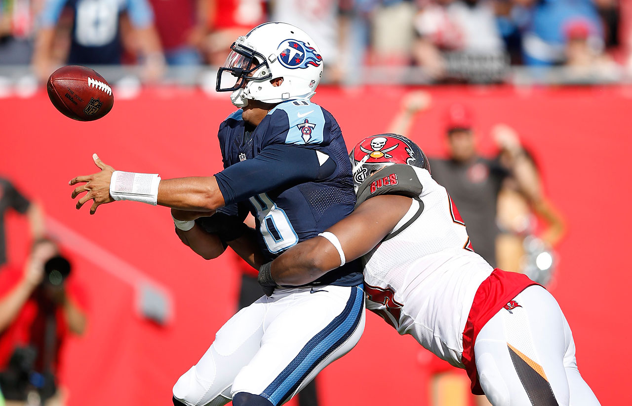 Marcus Mariota of the Tennessee Titans fumbles the ball after being sacked by Gerald McCoy of the Tampa Bay Buccaneer.