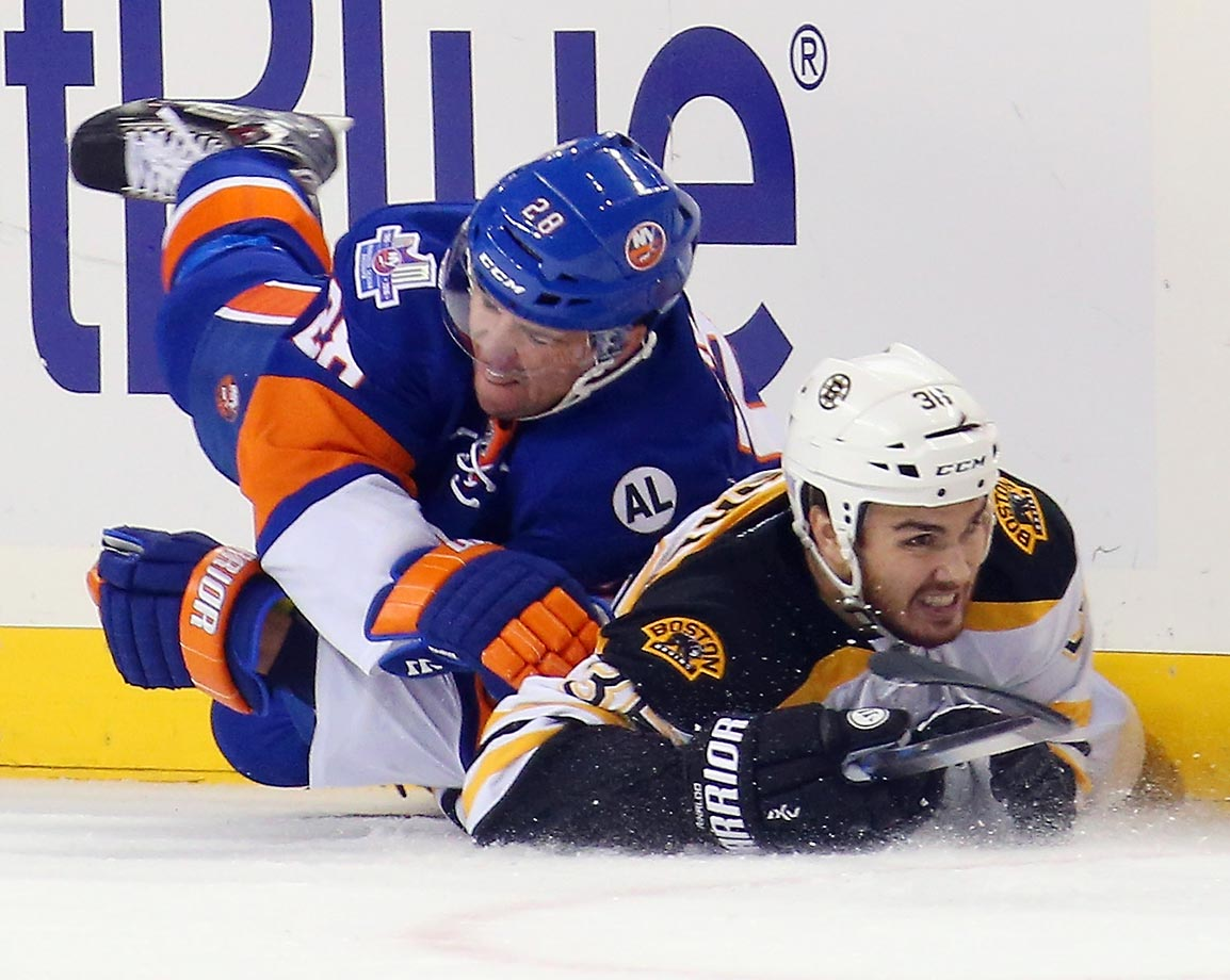 Marek Zidlicky of the New York Islanders and Zac Rinaldo of the Boston Bruins collide at a game in Brooklyn. The Bruins defeated the Islanders 5-3.