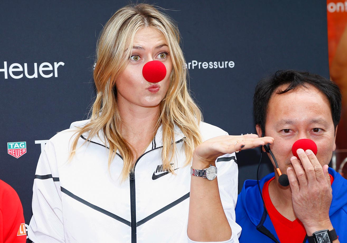 Maria Sharapova and former tennis player Michael Chang pose with red noses to support the Association Theodora fund event.