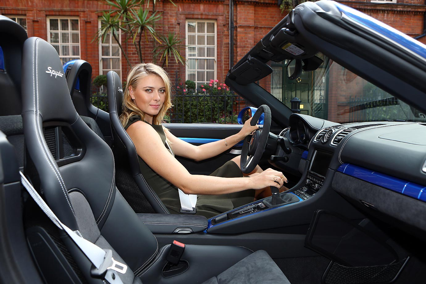 Maria Sharapova drops in at Porsche Mayfair to go for a spin in the UK's only brand new Porsche Boxster Spyder, on her way to the WTA Pre-Wimbledon Party at Kensington Roof Gardens in London.