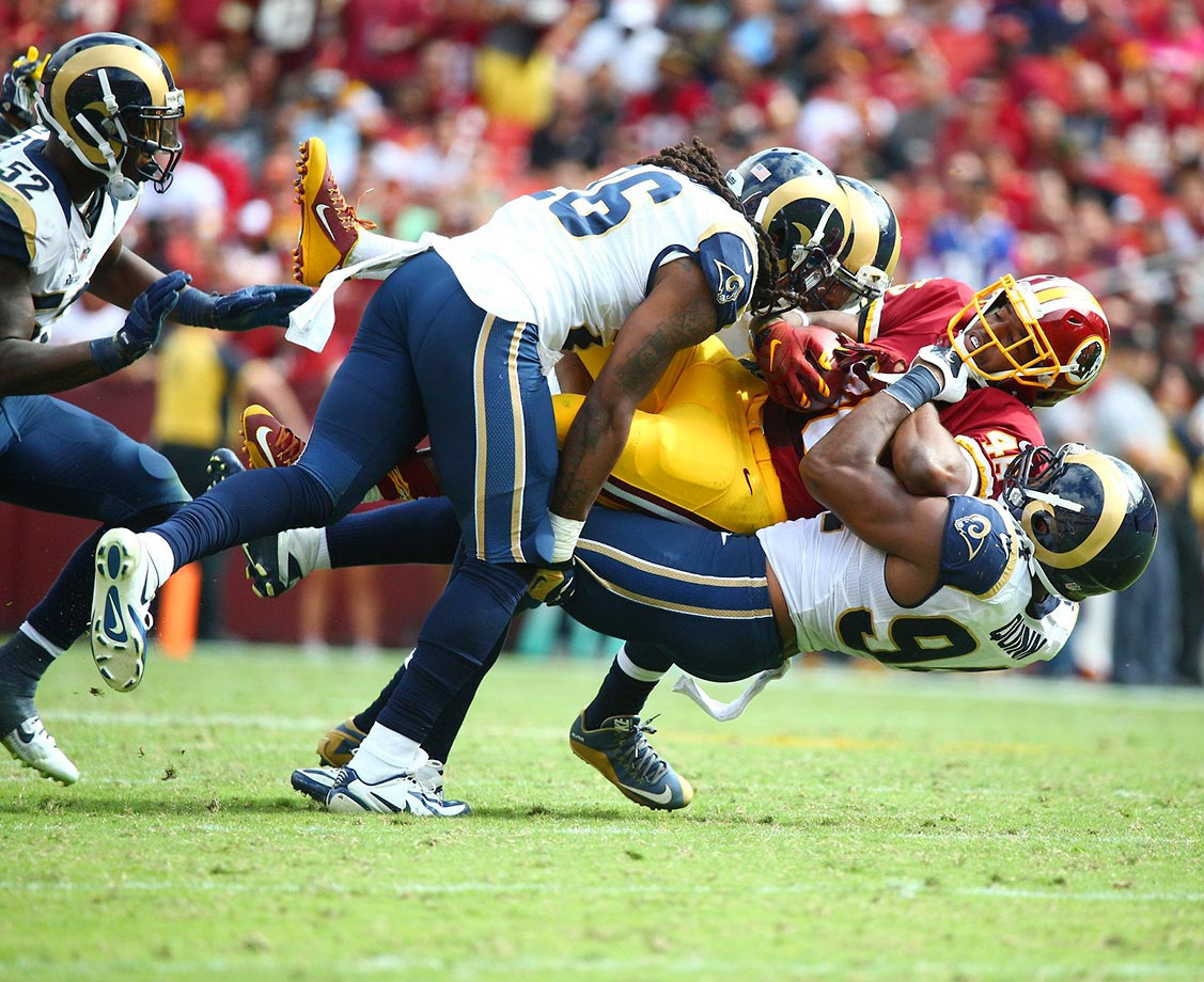 Mark Barron (26) and Robert Quinn (94) gang tackle Alfred Morris.