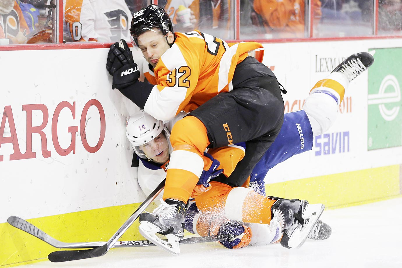 Philadelphia Flyers' Mark Streit (32) collides with New York Islanders' Thomas Hickey during their game in Philadelphia. New York won 3-2 in a shootout.