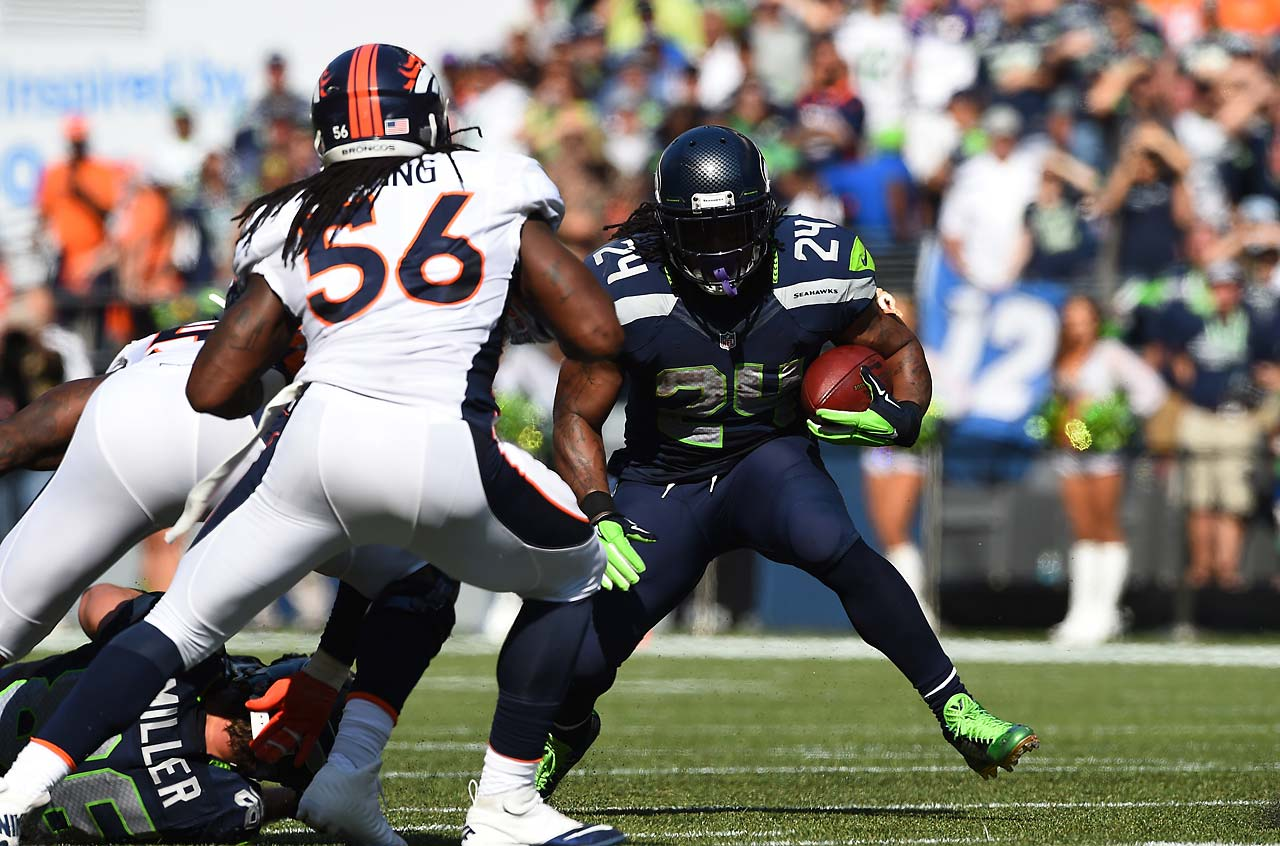 Marshawn Lynch scored a touchdown in overtime as Seattle defeated Denver in the rematch of last season's Super Bowl teams.