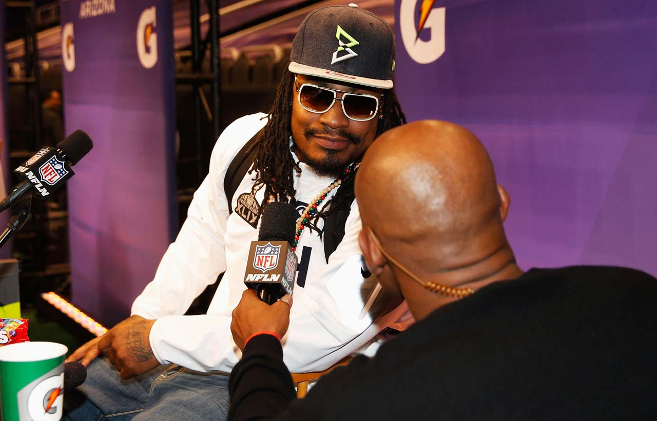 "Marshawn Lynch answers a question at media day with his now viral ""I'm here so I won't get fined."""
