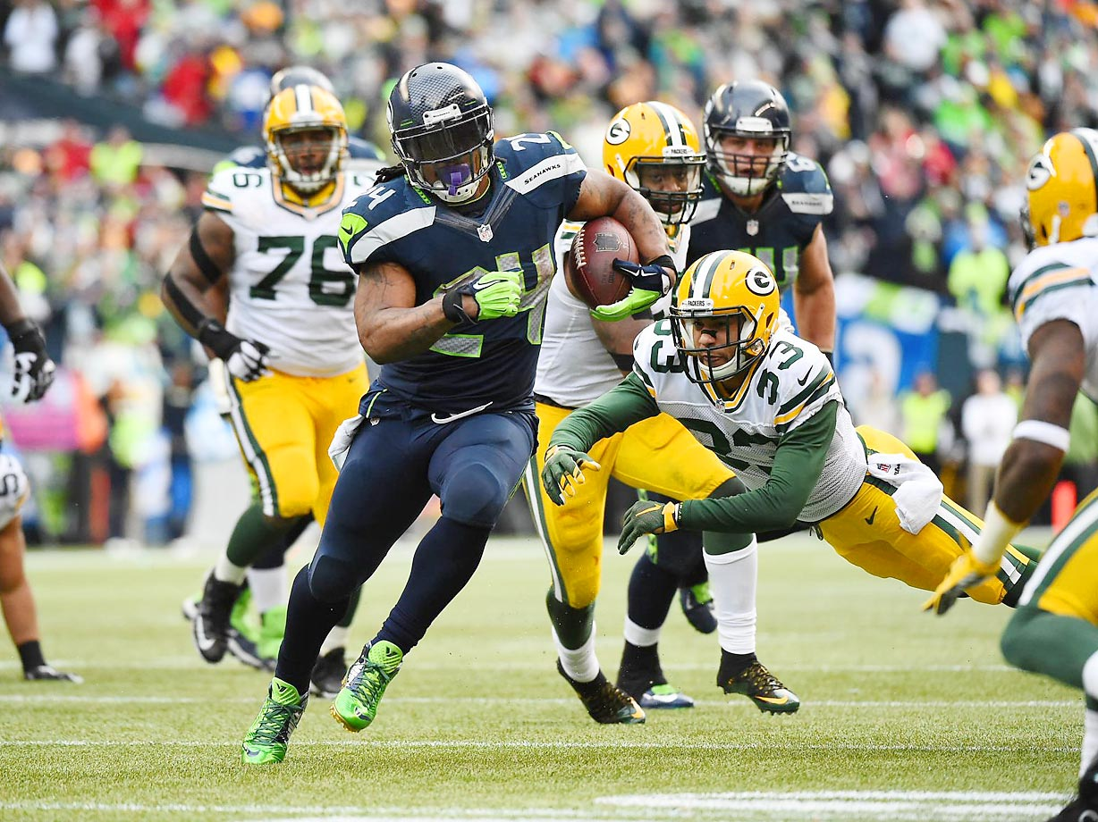 Seattle Seahawks running back Marshawn Lynch (24) tries to escape Green Bay Packers cornerback Micah Hyde (33) during the NFC Championship Game at CenturyLink Field in Seattle on Jan. 18.