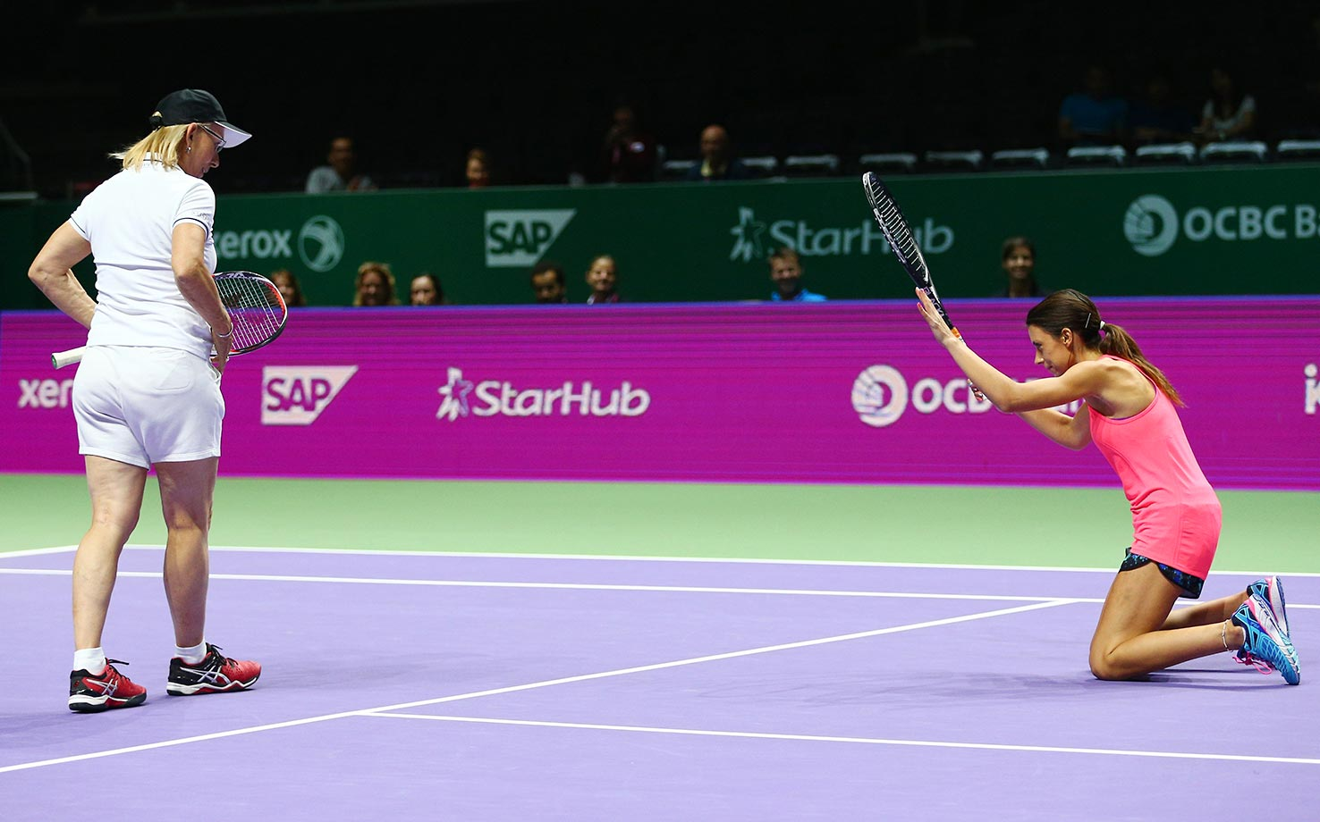 Martina Navratilova and Marion Bartoli during a legends doubles match against Tracy Austin and Arantxa Sanchez-Vicario in Singapore.