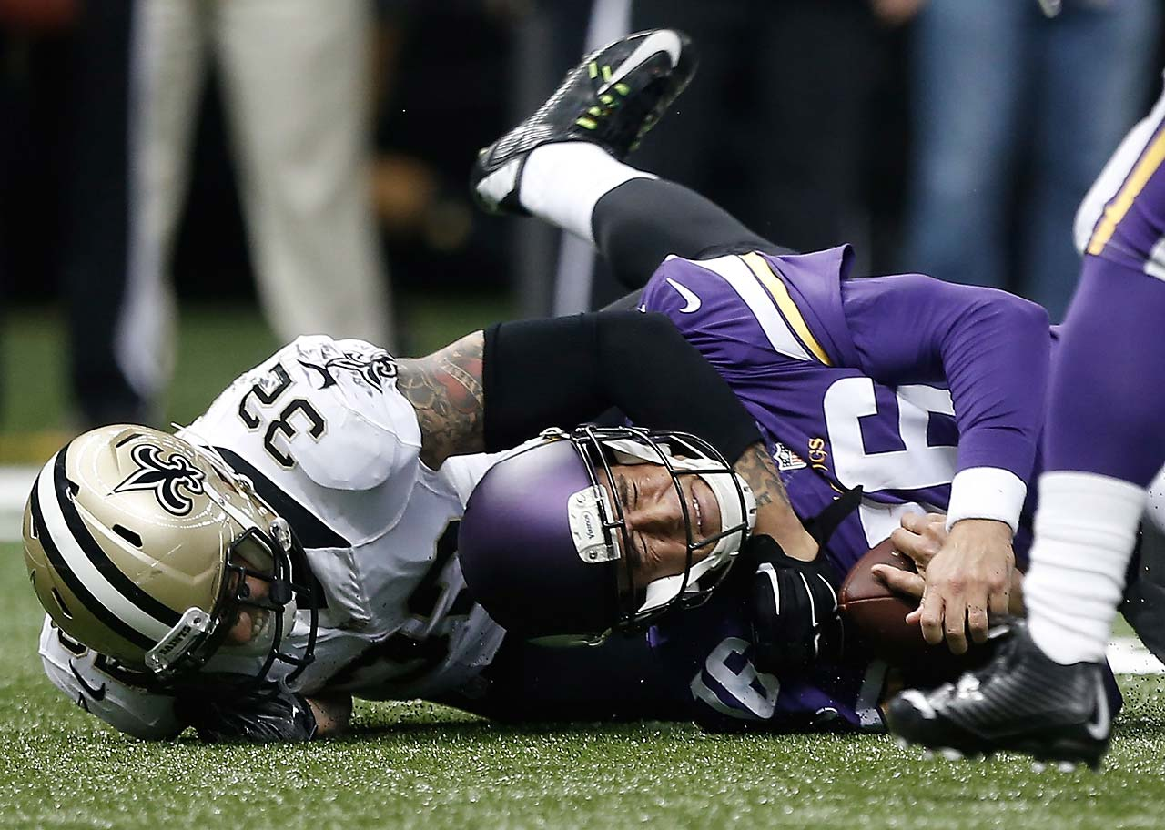 Matt Cassel of the Minnesota Vikings is sacked by Kenny Vaccaro of the New Orleans Saints.