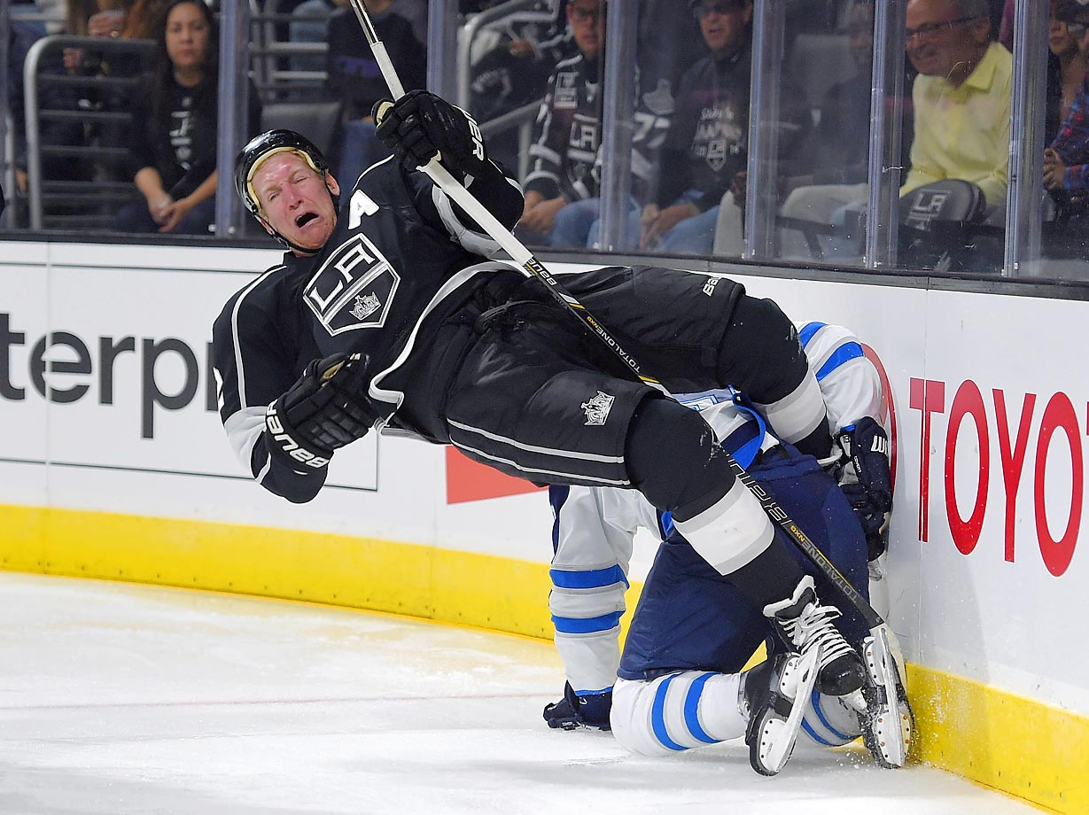 Kings defenseman Matt Greene tangles with Jets center Jim Slater on Sunday.