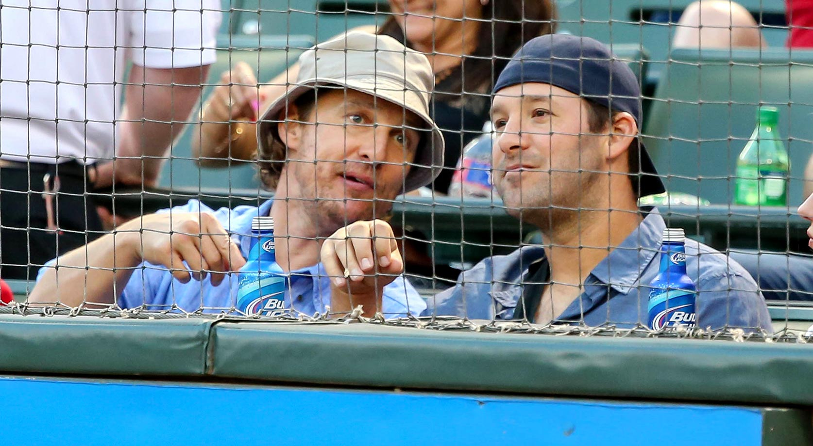 Texas fans Matthew McConaughey and Tony Romo take in a Rangers game.