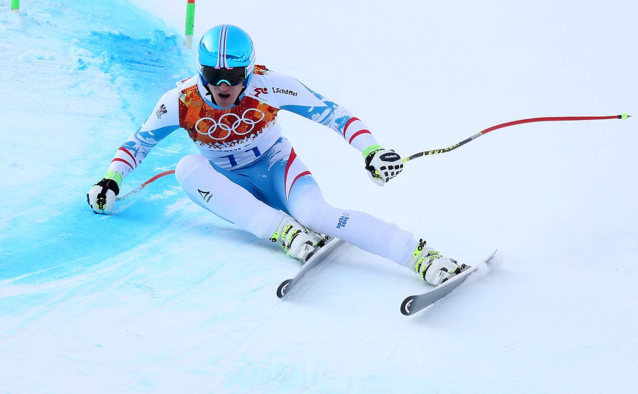 Matthias Mayer of Austria stunned the men's downhill field by covering the course in 2 minutes, 6.23 seconds to edge Italy's Christof Innerhofer by 0.06 seconds.