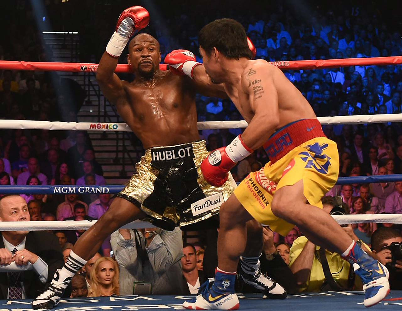 Floyd Mayweather won a unanimous decision over Manny Pacquiao to run his record to 48-0 on May 2. Here are SI's best pictures from the bout.