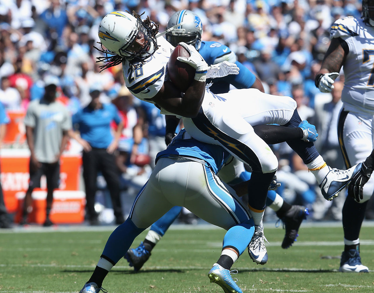 Running back Melvin Gordon of the San Diego Chargers is tackled by the Detroit Lions defense.