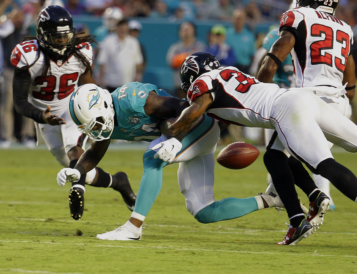 The defense gets a shot in the arm, with DT Ndamukong Suh stuffing runners in the middle. But offensively, the Dolphins are resting all of their passing hopes on two very young receivers -- a sophomore (Jarvis Landry) that averaged just 9.0 yards per catch, and a rookie (DeVante Parker), who's coming off of foot surgery. What could go wrong!?!