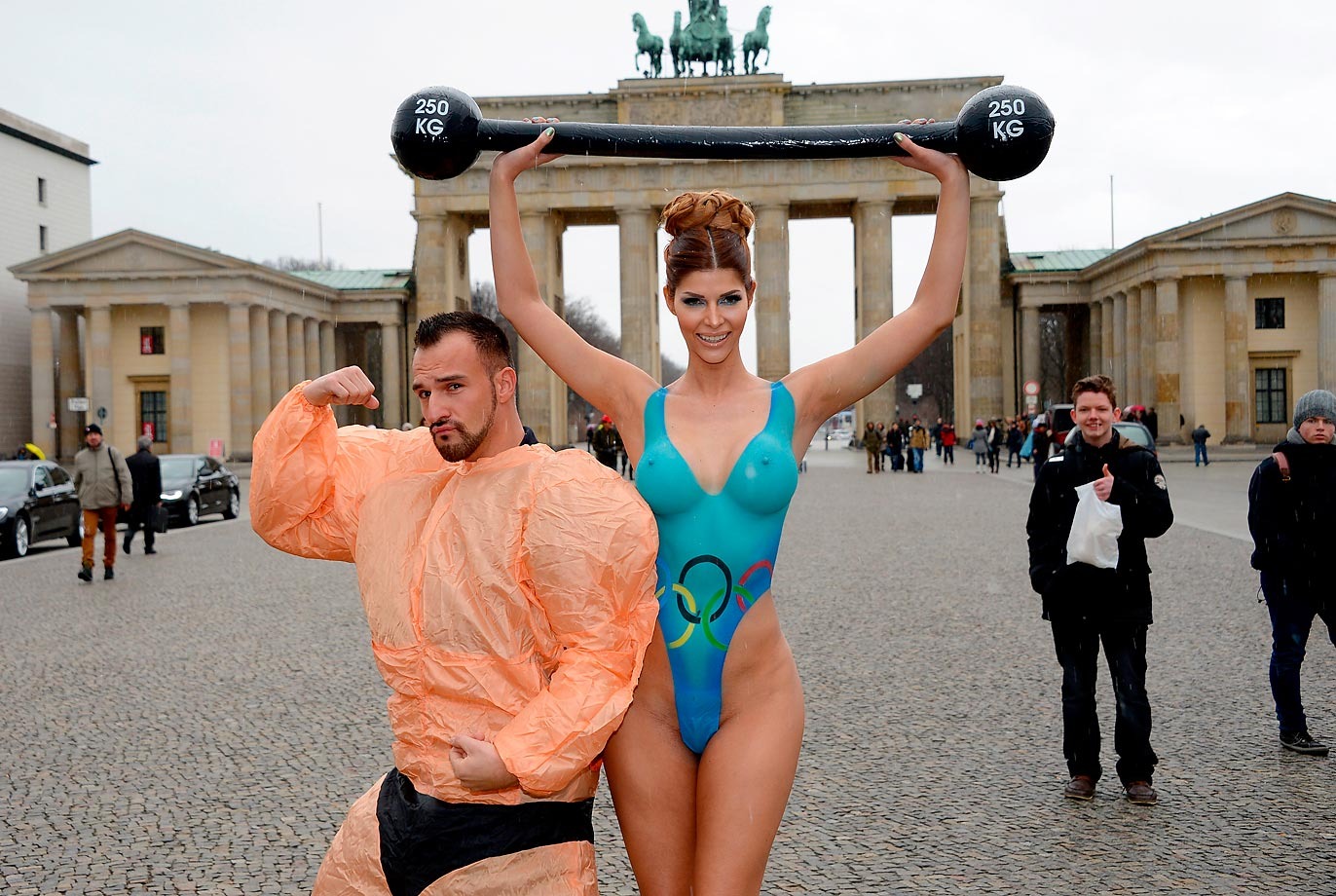 Micaela Schaefer shows a little Olympic spirit during a photocall at the Brandenburg Gate in Berlin.