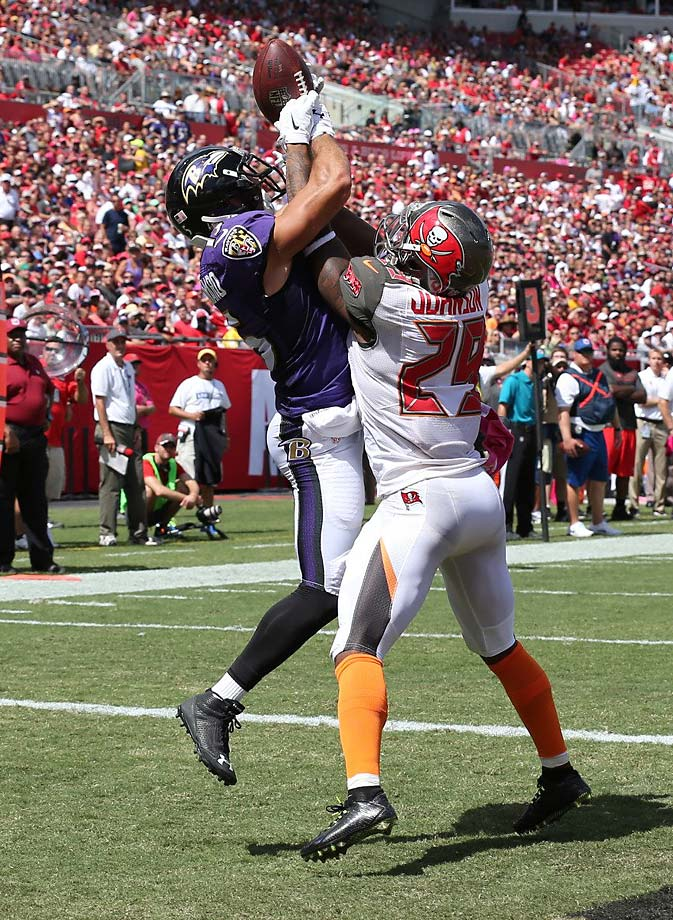 Michael Campanaro of the Ravens made this juggling catch against Leonard Johnson for a touchdown.