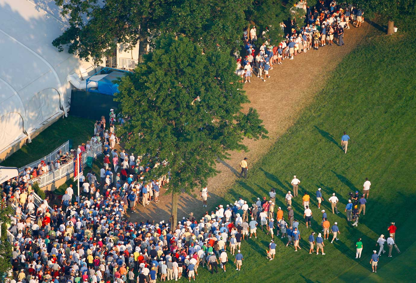 With a one-stroke lead heading to the final hole at the 2012 U.S. Open, Phil Mickelson (yellow shirt) blew his chance to win a third straight major when his tee shot bounced off this hospitality tent at Winged Foot and landed way astray of the fairway. He ended up with a double bogey.