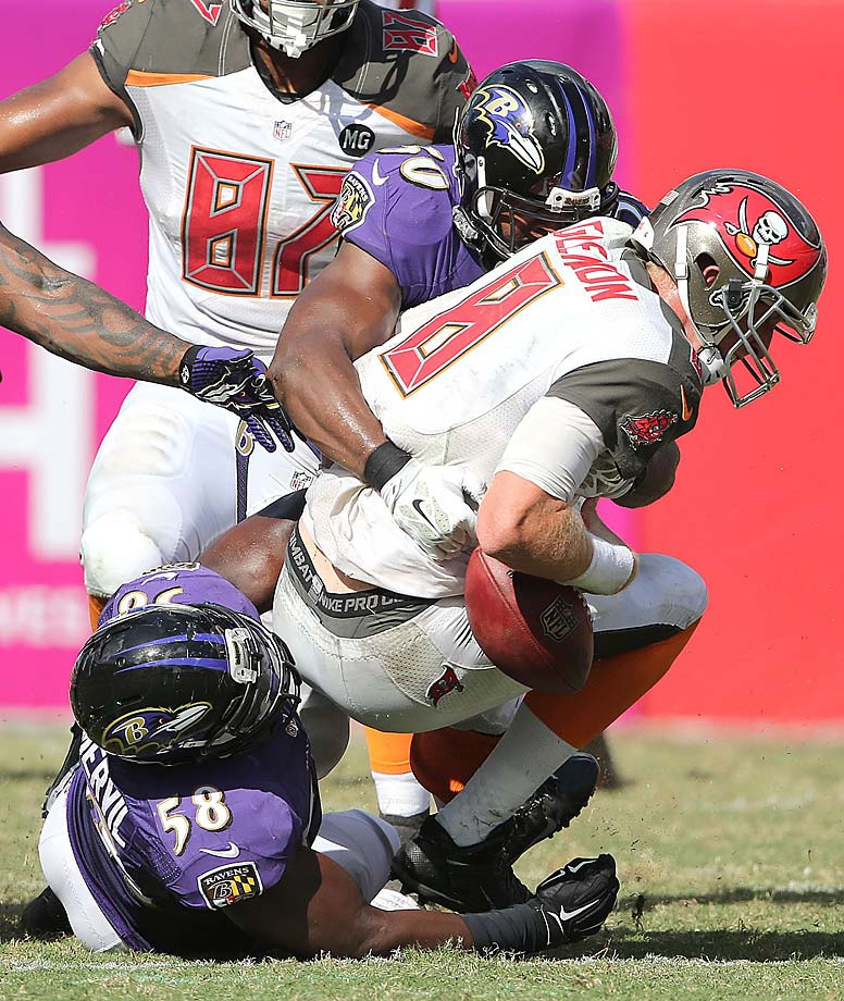 Mike Glennon looses his grip on the ball during Sunday's loss to Baltimore.