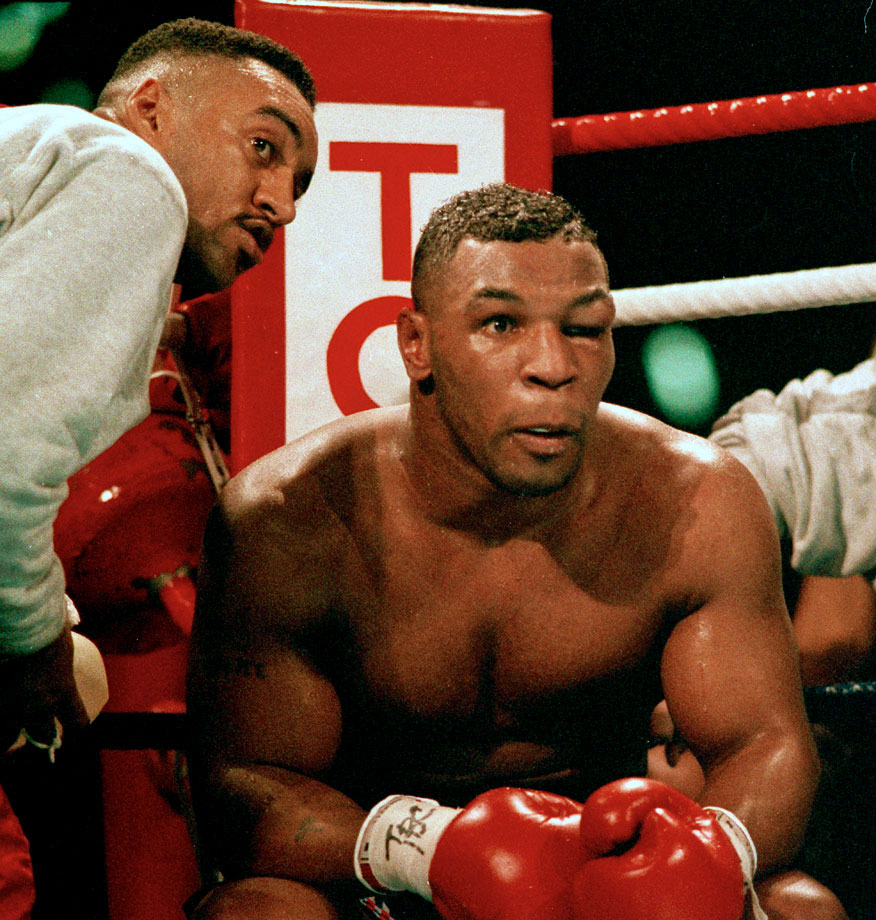 As he waited to come out for the seventh round, Tyson no longer looked like the Baddest Man on the Planet, merely a badly battered one. His inexperienced cornermen, including Aaron Snowell (left) seemed ill-equipped to help their fighter.