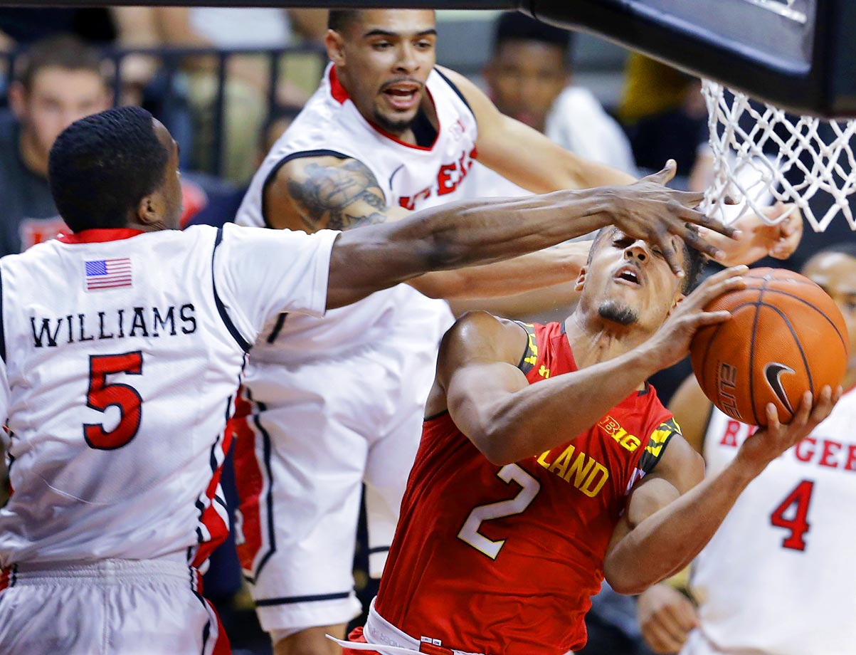 Rutgers guard Mike Williams and teammates try to block a shot by Maryland guard Melo Trimble.