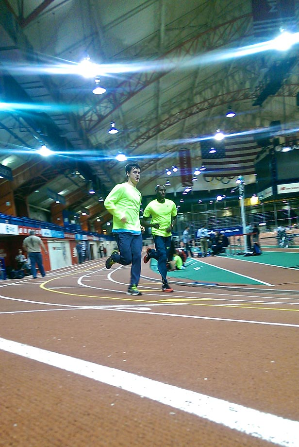 Mikey Brannigan, one of the top  high school middle distance runners in the U.S., and track legend Bernard Lagat, one of the top middle-distance runners in the world, share a moment in a cool down lap at the end of the 108th annual NYRR Millrose Games.