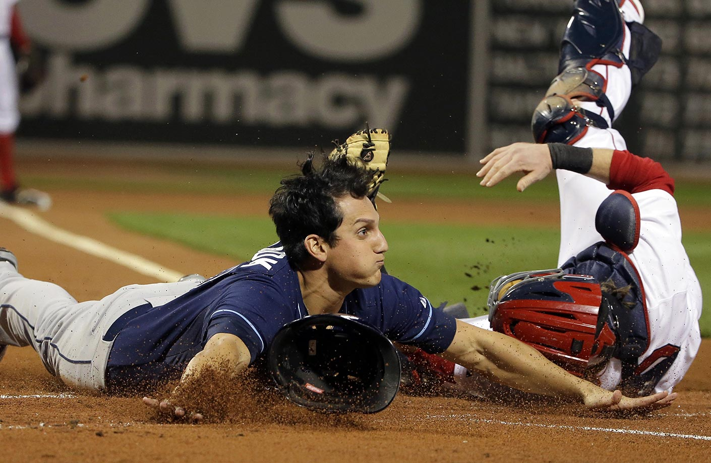 Mikie Mahtook of the Tampa Bay Rays slides in safely against Ryan Hanigan of the Boston Red Sox.