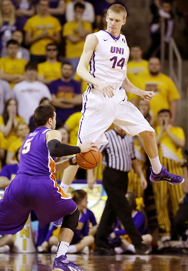 Evansville guard Mislav Brzoja drives around Northern Iowa forward Nate Buss.