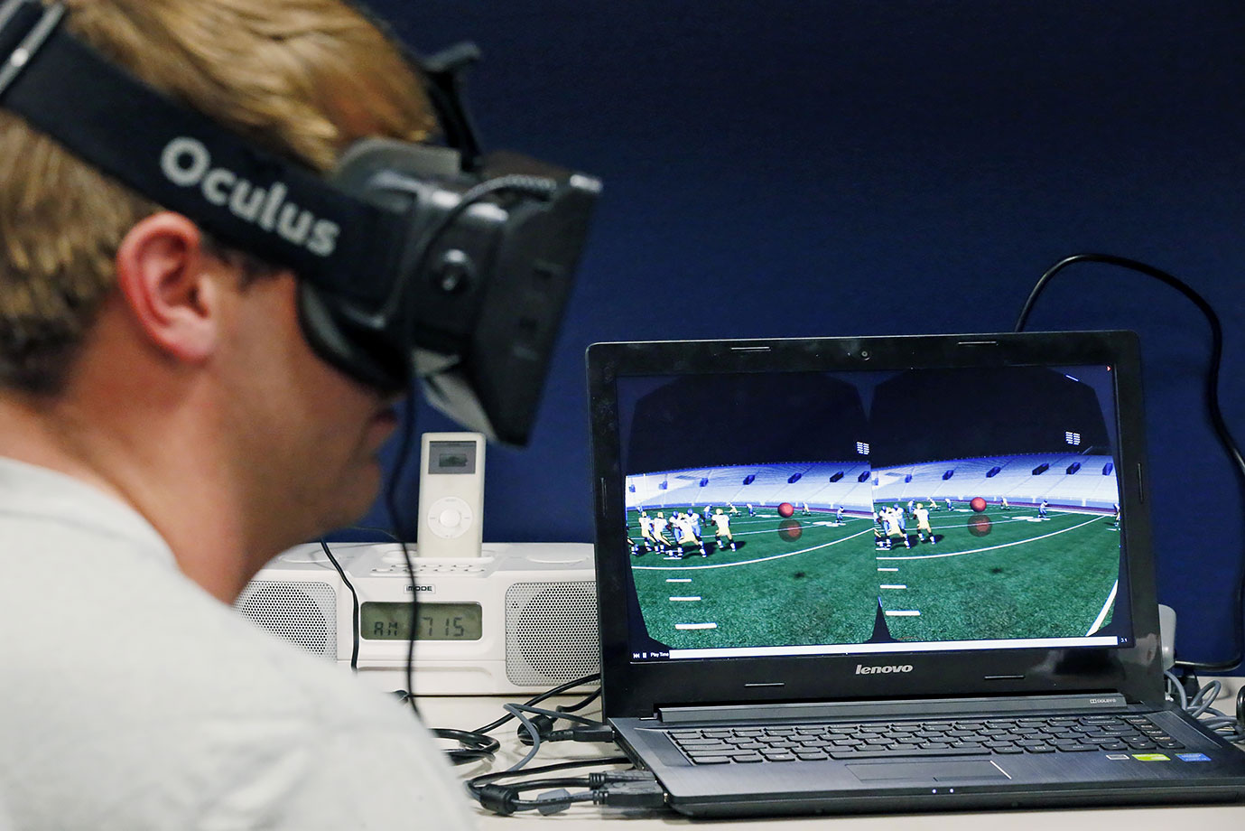 Ole Miss quarterback Ryan Buchanan uses a virtual reality headset to make football play decisions on July 27, 2015 at the Manning Center in Oxford, Miss.