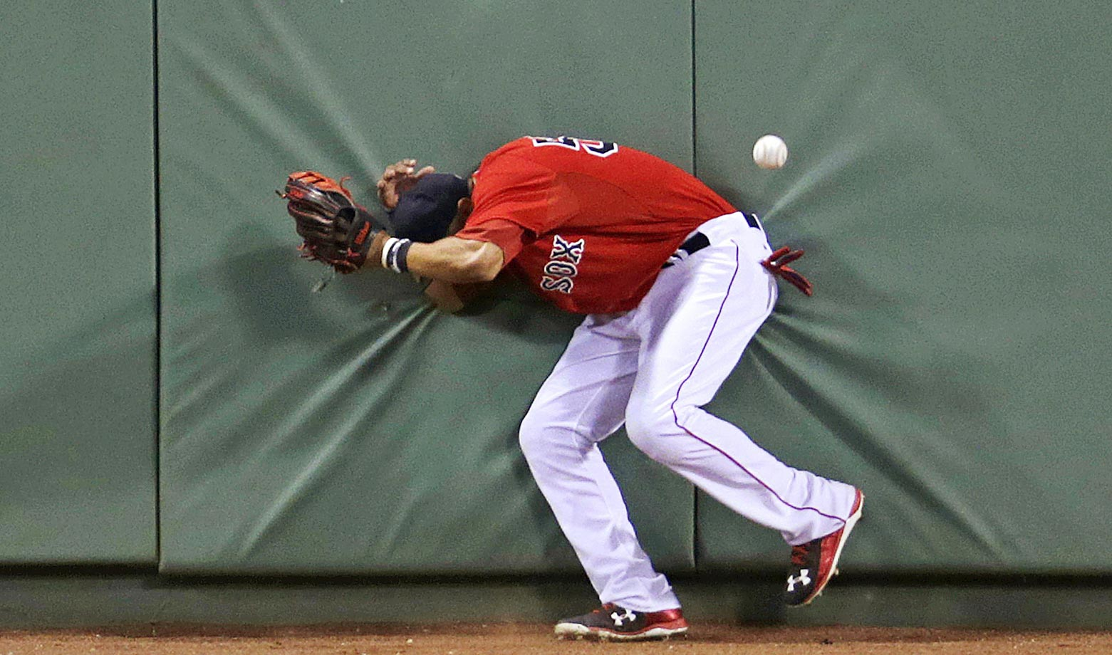 Mookie Betts of the Boston Red Sox hits the wall in a game against the Detroit Tigers.