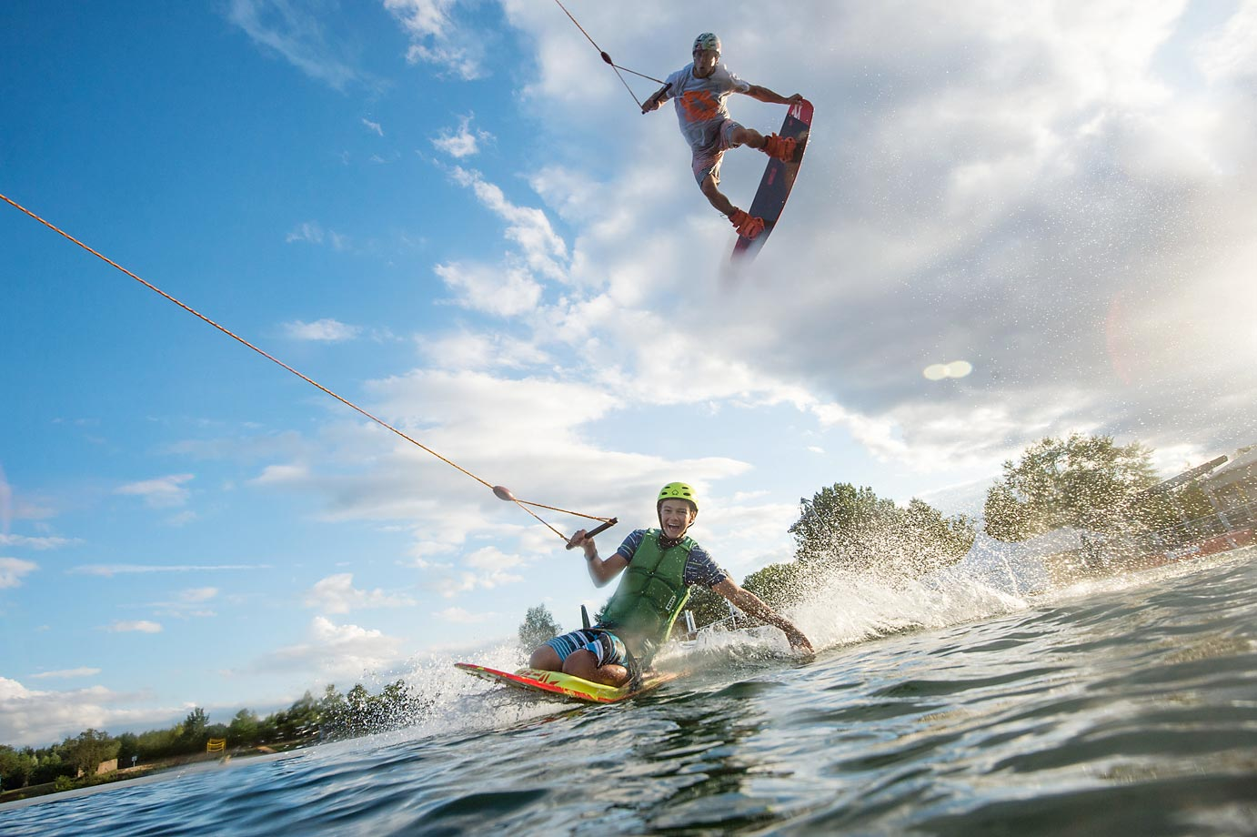 Wakeboarders Moritz Petri and Cedric Schmidt during a training session at 'Hotspot Seepark' in Niederweimar, Germany.