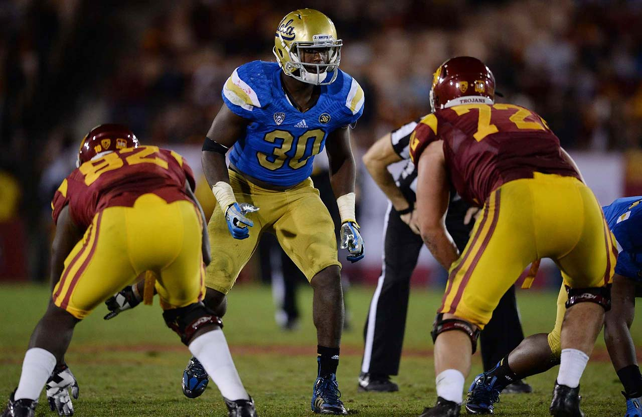 "5. UCLA vs. Texas in Arlington, Texas (Sept. 13, 8 p.m., FOX): Led by quarterback Brett Hundley and two-way star Myles Jack, the Bruins enter this fall as dark horse playoff contenders -- lofty expectations for a program that last reached a BCS bowl in 1998. Conversely, new Texas coach Charlie Strong has already downplayed the hype surrounding his team. ""We will not be in the national championship game,"" he said in April. The most pressing question for the Longhorns: Who will be the starting quarterback? Injury-maligned David Ash, sophomore Tyrone Swoopes and heralded true freshman Jerrod Heard will all compete for the job."