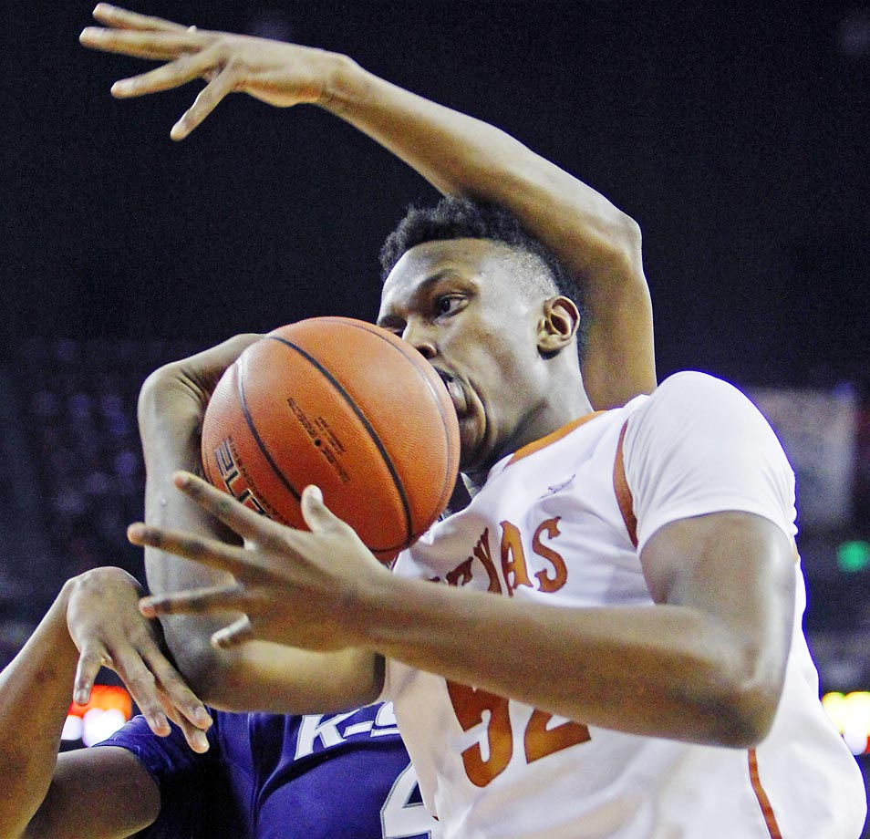 Texas forward Myles Turner comes down with a kisser of a rebound against Kansas State.