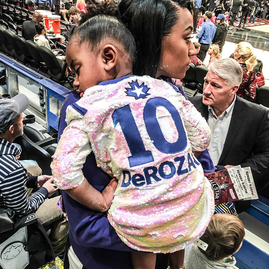 Demar Derozan's daughter Diar asleep in her mother's arms as All-Star game winds down.
