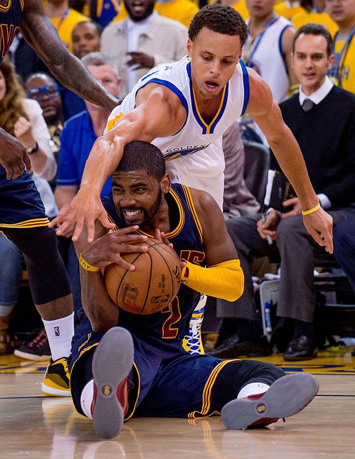 Steph Curry pressures Kyrie Irving.