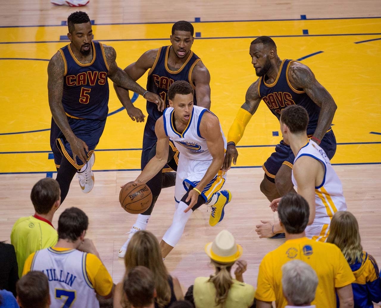 Cleveland's defenders close in on Steph Curry.