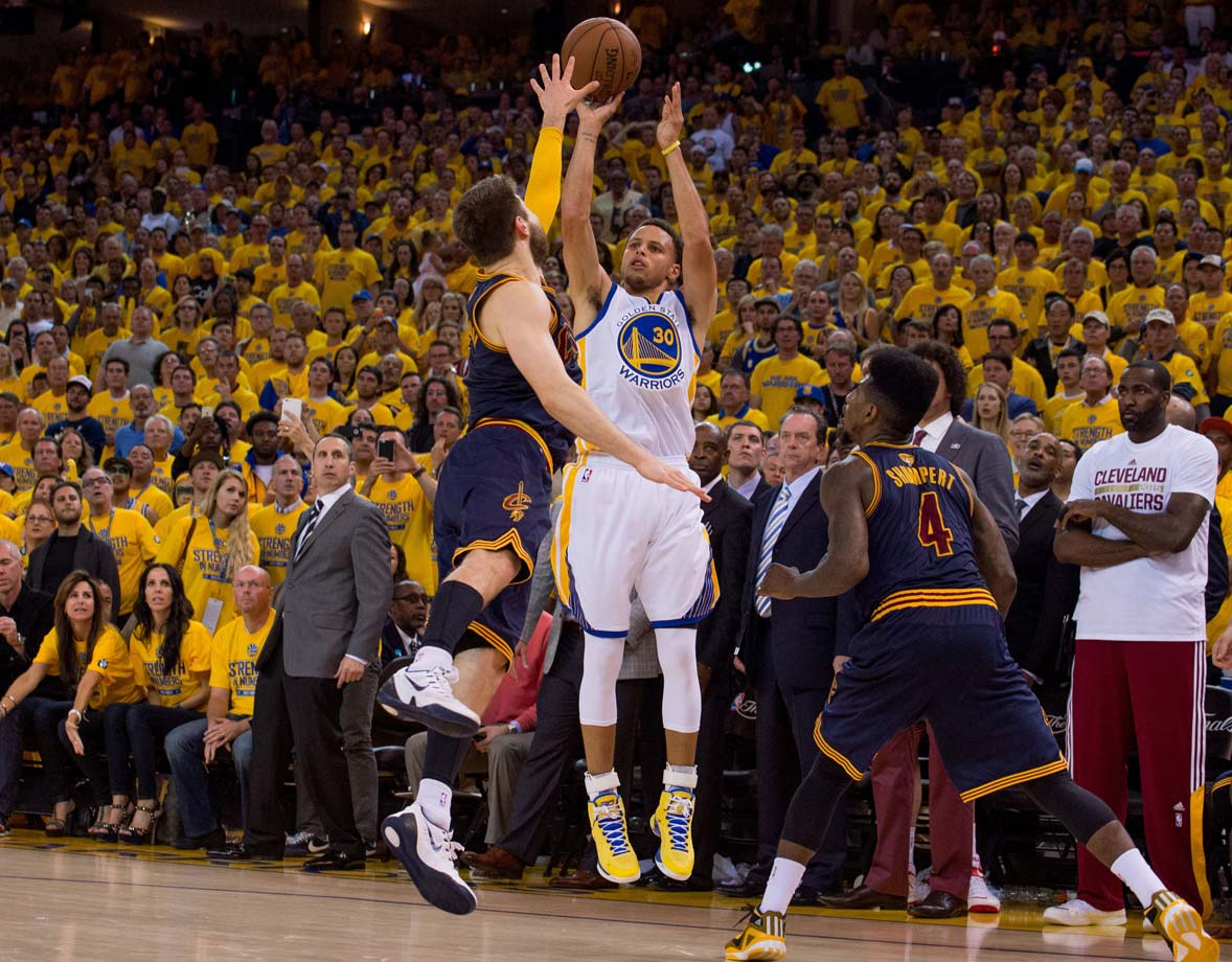 Matthew Dellavedova contests a shot by Stephen Curry in overtime.