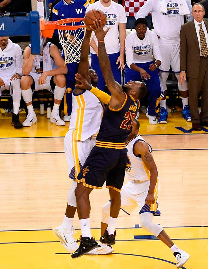 Draymond Green had four blocks, including this one of LeBron James.