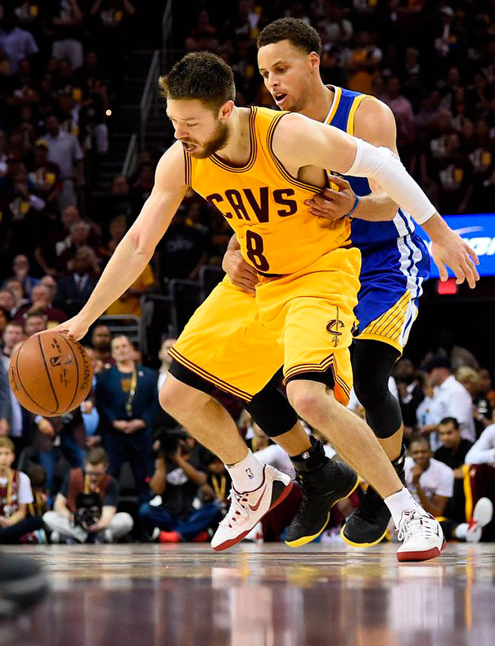 Despite Steph Curry's attempt to hold  Matthew Dellavedova back, the Cavs guard kept driving toward the basket on this play and hit a circus shot off the glass and drew a foul.