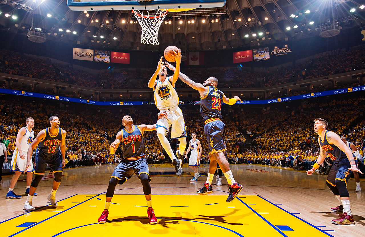 Shaun Livingston drives against LeBron James and James Jones. The Warriors will try to win their first title since 1975 on Tuesday night in Cleveland.