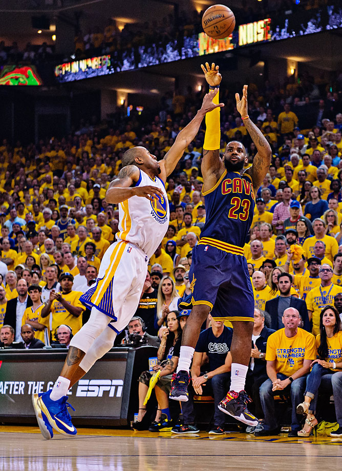 Andre Iguodala lunges at LeBron James on this shot attempt. James made 15 of his 34 attempts and sank seven free throws.