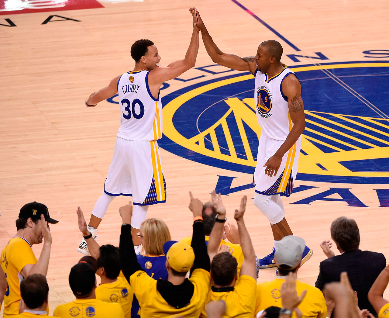 Andre Iguodala gets a high-five from Steph Curry after an offensive rebound and put back in which he also drew a foul. Iguodala finished with  14 points, eight rebounds and seven assists.