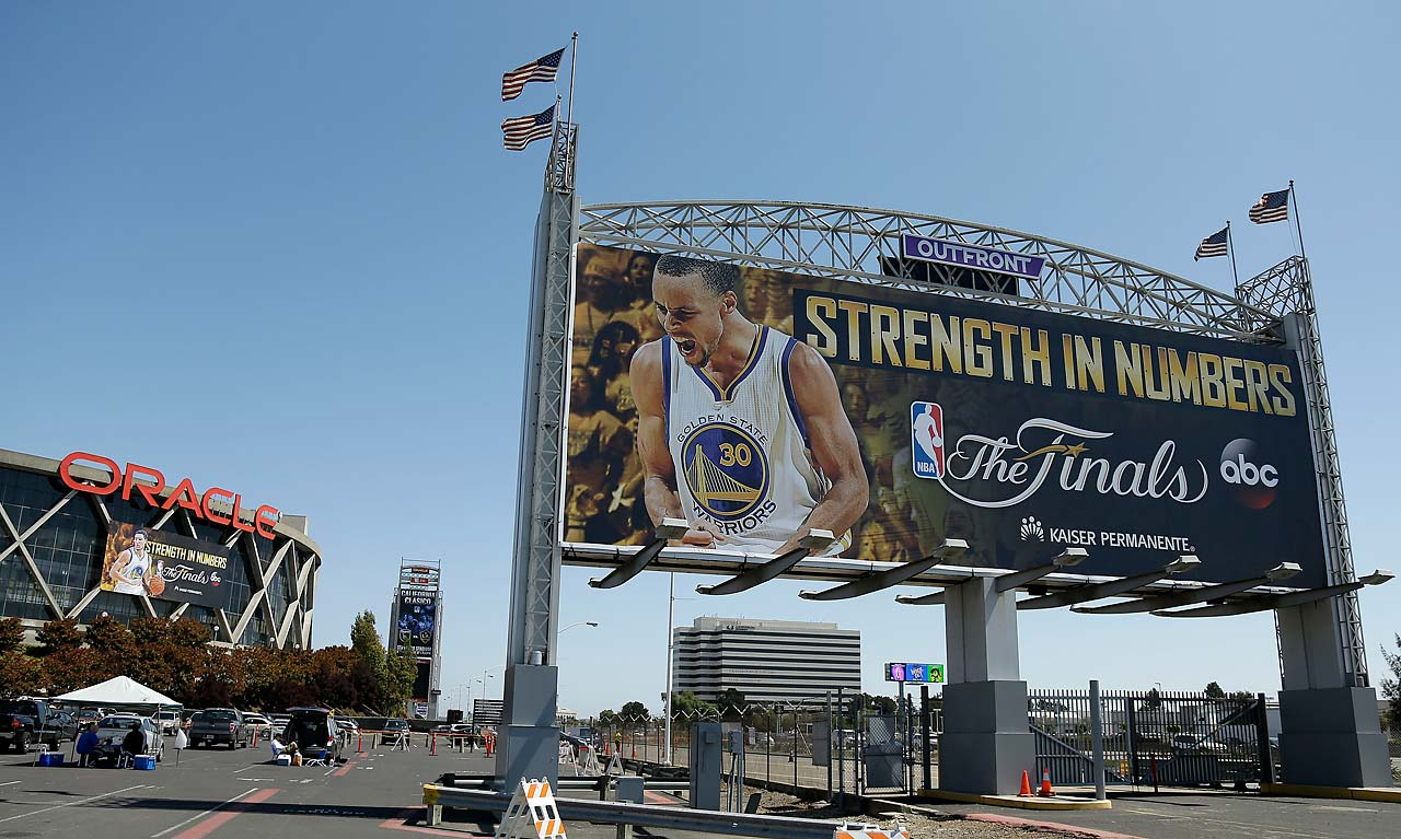 Golden State Warriors guard Stephen Curry is shown on a sign outside of Oracle Arena.