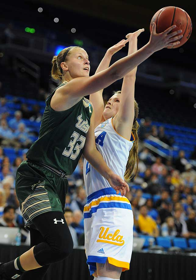 South Florida's Kitija Laksa goes for a scoop shot by UCLA's Kari Korver.