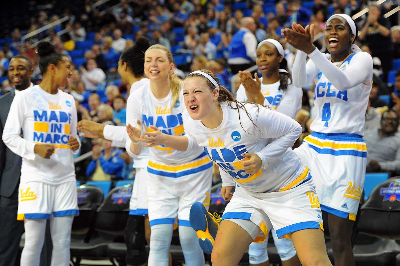 The UCLA bench cheers as their teammates build a double-digit lead against South Florida.
