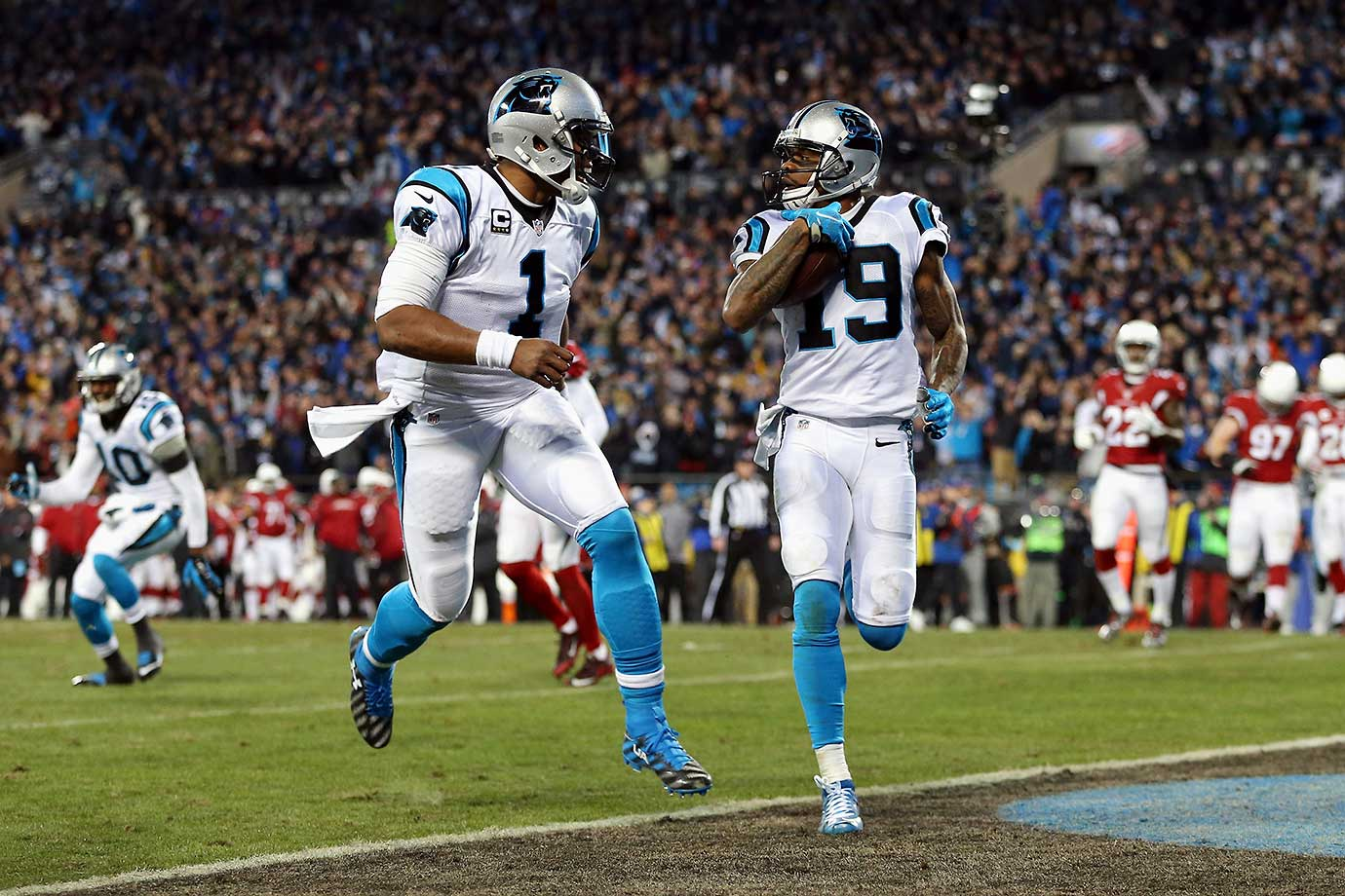 Cam Newton celebrates as Ted Ginn Jr. scores a touchdown in the first quarter of the NFC Championship game.
