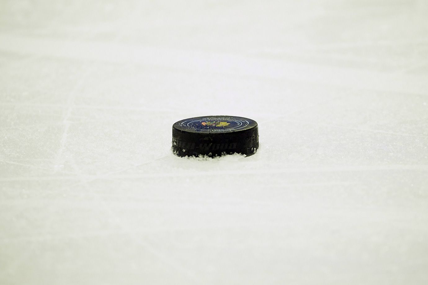 """A puck is a hard rubber disc that hockey players strike when they can't hit one another."""