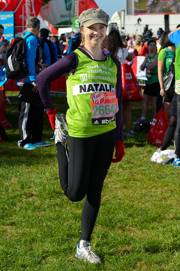 Natalie Dormer stretches ahead of the Virgin Money London Marathon on April 13, 2014 in London.