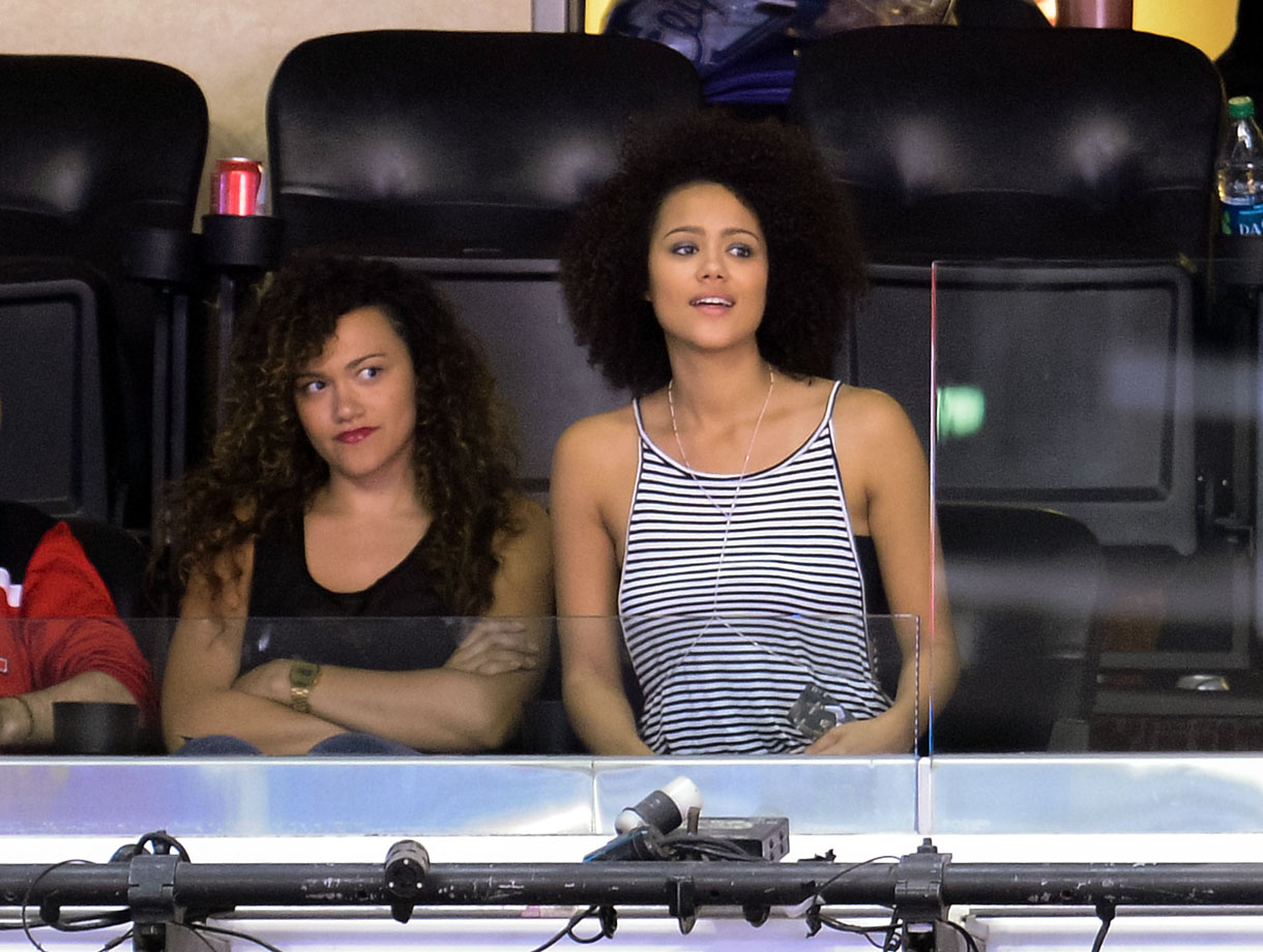 Nathalie Emmanuel and her sister Louise attend an NBA game between the Los Angeles Clippers and Atlanta Hawks at Staples Center on March 8, 2014 in Los Angeles.
